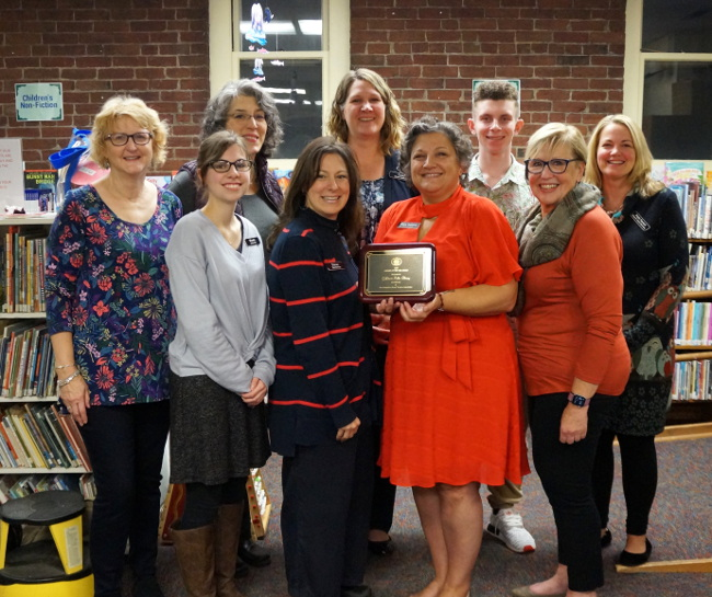 Staff of Goffstown Public Library pose with Director Dianne Hathaway holding the NHLTA award.